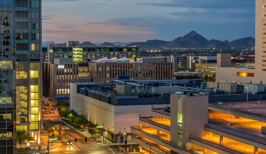 Phoenix, Arizona USA evening city view with mountain in the background